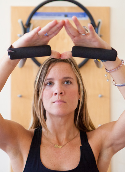 Woman using pilates equipment in pilates studio in San Francisco
